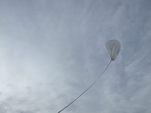 The balloon is released!  Downrange, Big Bill is moving into position to release the gondola smoothly once the balloon is vertical.
